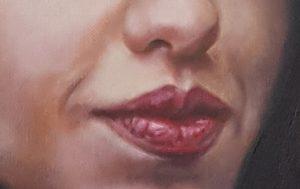 Detail van een schilderij: volle rode lippen